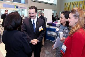 New Jersey State Assembly Speaker Vincent Prieto greets Chamber Board Members and President & CEO Maria Nieves (pictured right of the Speaker) at the Chamber's 2015 Annual Meeting.